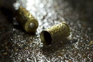 Bullets on ground on a rainy day.