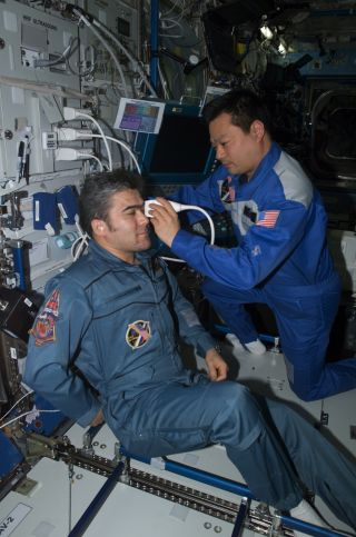Astronaut Leroy Chiao performs an ultrasound examination of the eye on cosmonaut Salizhan Sharipov aboard the International Space Station. NASA helped turn the station's ultrasound machine into an all-purpose diagnostic imager with a direct line to doctor