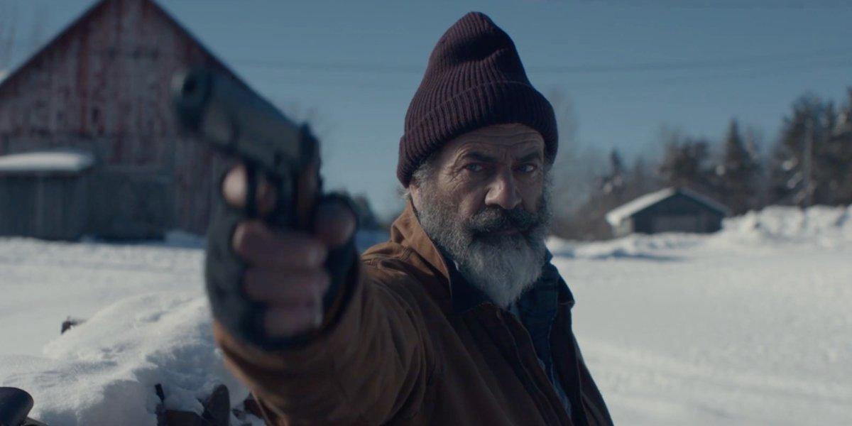 Fatman Mel Gibson aims a gun as Santa Claus