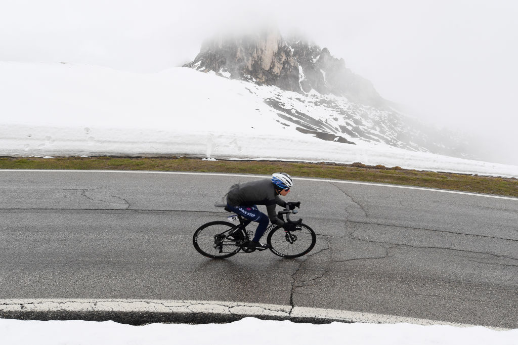 CORTINA DAMPEZZO ITALY MAY 24 Remco Evenepoel of Belgium and Team Deceuninck QuickStep passing through Passo Giau 2233m landscape during the 104th Giro dItalia 2021 Stage 16 a 153km stage shortened due to bad weather conditions from Sacile to Cortina dAmpezzo 1210m girodiitalia Giro on May 24 2021 in Cortina dAmpezzo Italy Photo by Tim de WaeleGetty Images