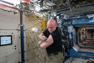 Scott Kelly gives flu shot