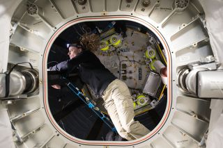 NASA astronaut Kate Rubins performs tests and replaces parts inside the Bigelow Expandable Activity Module (or BEAM), a privately built inflatable room, on the International Space Station on Sept. 5, 2016.