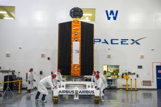Airbus Defence and Space technicians position the Sentinel-6 Michael Freilich spacecraft for fueling inside SpaceX's Payload Processing Facility at Vandenberg Air Force Base in California, on Oct. 22, 2020.