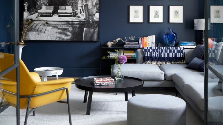 Navy blue living room with yellow chair and internal crittall doors