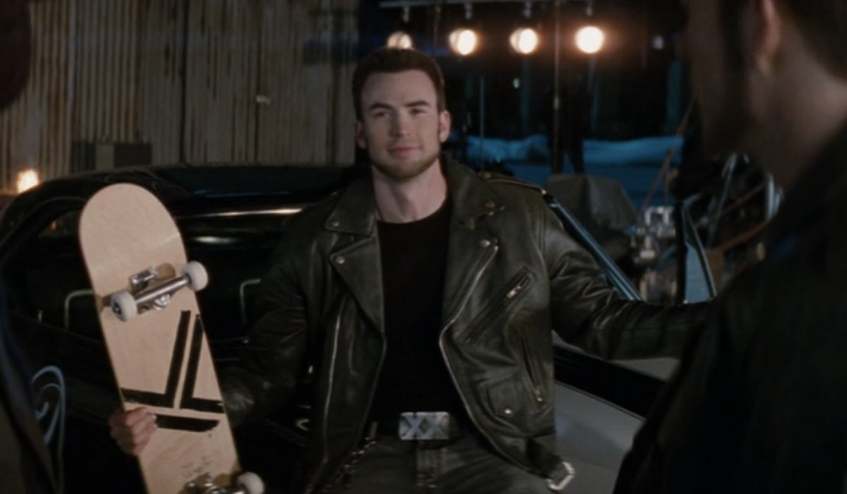 Chris Evans gestures with a skateboard in his hands in Scott Pilgrim vs The World.