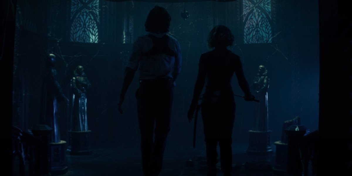 loki and sylvie walking through citadel with time-keeper statues in loki finale