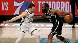 James Harden #13 of the Brooklyn Nets tries to get past Pat Connaughton #24 of the Milwaukee Bucks during game seven of the Eastern Conference second round at Barclays Center on June 19, 2021 in the Brooklyn borough of New York City.
