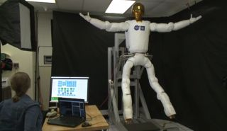 NASA's Robonaut 2 flexes its newly built legs in this still from a video demonstration of the robot's new capabilities released Dec. 9, 2013.