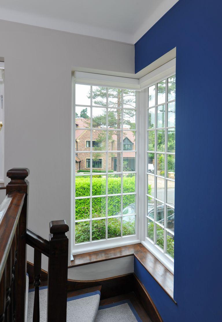White sash windows in blue hallway
