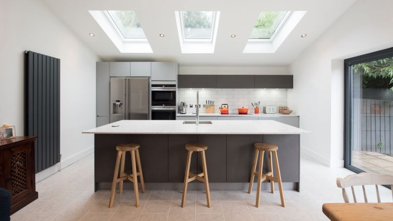 a clean, minimalistic kitchen—achieve a kitchen like this with our kitchen cleaning guide