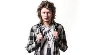 A portrait of Asking Alexandria's Ben Bruce looking into the camera