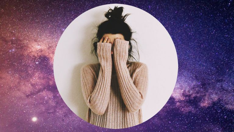 Young woman upset with a starry sky background