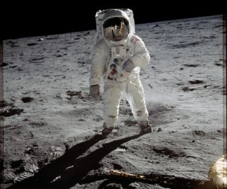 Astronaut Buzz Aldrin walks on the surface of the moon near the leg of the lunar module Eagle during the Apollo 11 mission on July 20, 1969.