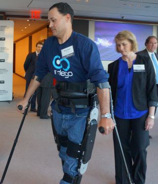 Michael Gore walks with the Indego Exoskeleton
