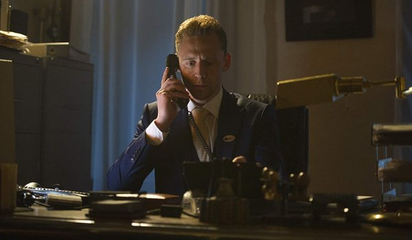 The Night Manager Tom Hiddleston at his desk, on the phone