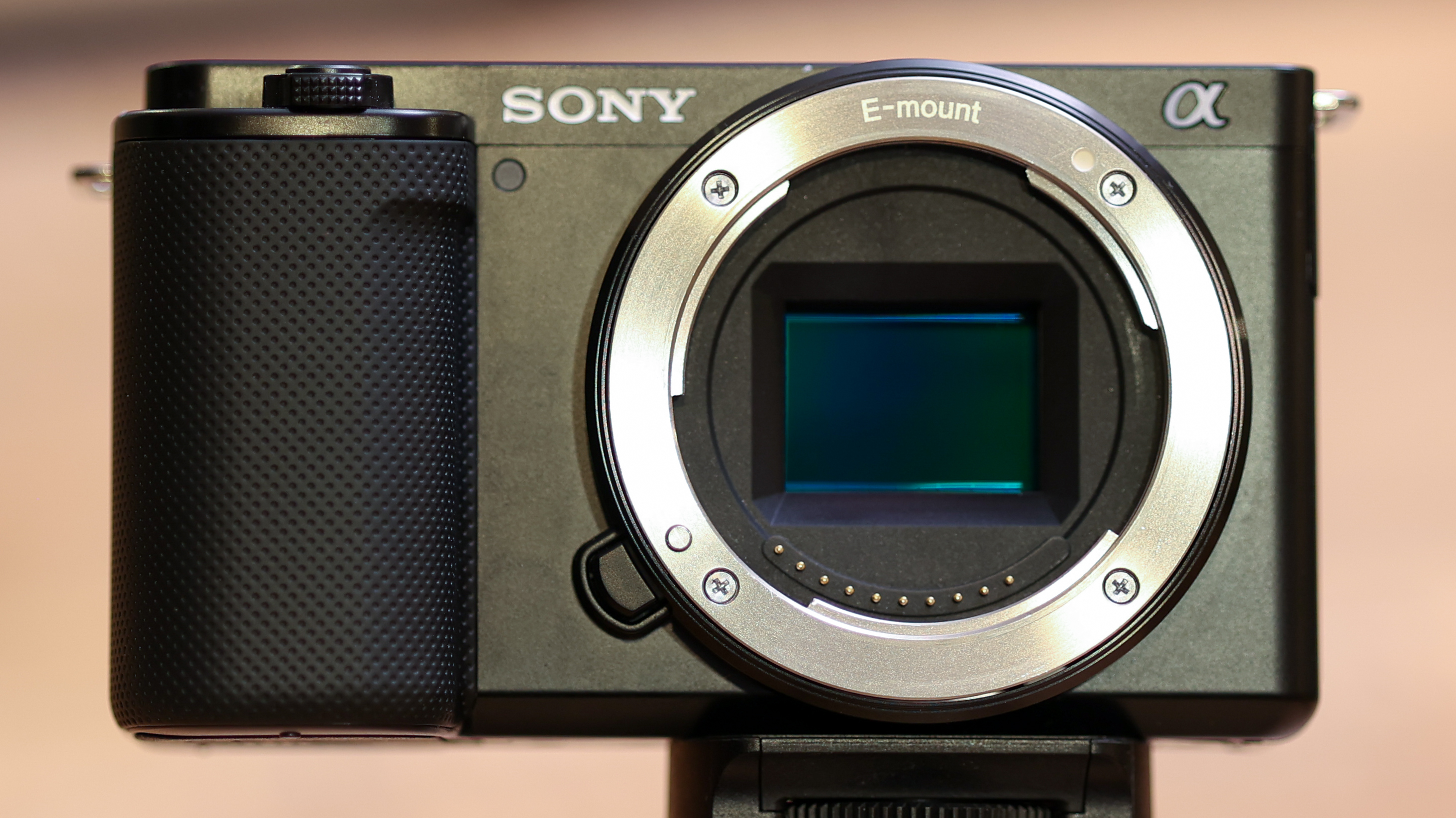 Close-up of the front of the Sony ZV-E10 without a lens
