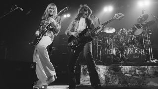 Alex Lifeson (left) and Geddy Lee performing with Canadian progressive rock group, Rush, at the Civic Center in Springfield, Massachusetts, during the band's All The World's a Stage tour, 9th December 1976