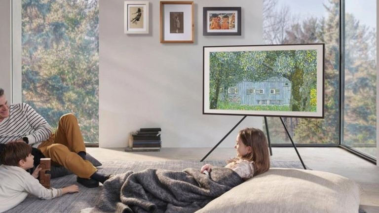 Samsung the Frame TV in living area with father and two kids