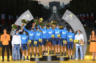 PARIS FRANCE SEPTEMBER 20 Podium Dario Cataldo of Italy Imanol Erviti of Spain Enric Mas Nicolau of Spain Nelson Oliveira of Portugal Jose Joaquin Rojas Gil of Spain Marc Soler Gimenez of Spain Alejandro Valverde Belmonte of Spain Carlos Verona Quintanilla of Spain and Movistar Team Jose Luis Arrieta of Spain Sports director of Movistar Team Pablo Lastras of Spain Sports director of Movistar Team Best Team Celebration Trophy Flowers Mask Covid safety measures during the 107th Tour de France 2020 Stage 21 a 122km stage from MantesLaJolie to Paris Champslyses TDF2020 LeTour on September 20 2020 in Paris France Photo by Stephan Mantey PoolGetty Images