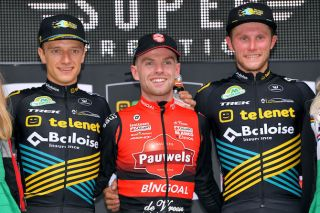 Elite men's winner Eli Iserbyt (Pauwels Sauzen-Bingoal) flanked by Telenet Baloise Lions duo Quinten Hermans (left) and Corne Van Kessel at the opening round of the 2019 Telenet Superprestige cyclo-cross series in Gieten