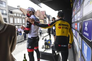 Matteo Trentin (UAE Team Emirates) gets a pat on the back from Wout van Aert (Jumbo-Visma) after finishing third at Gent-Wevelgem