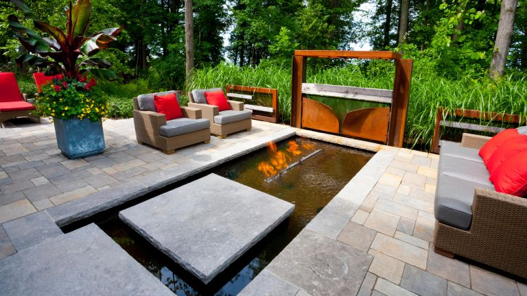 modern patio with gas fire in water