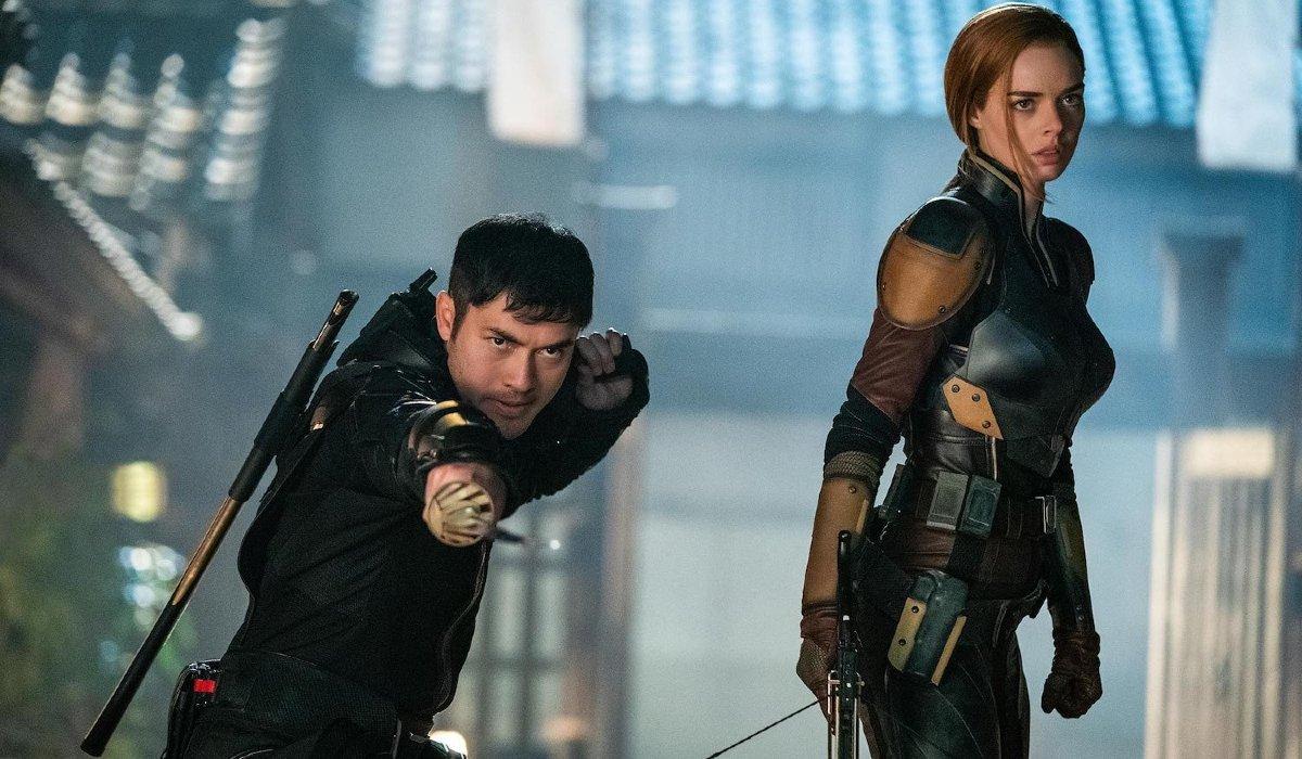 Henry Golding and Samara Weaving stand in battle in Snake Eyes.