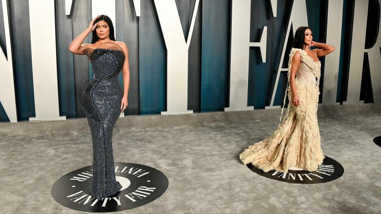 Kylie Jenner and Kim Kardashian (R) attend the 2020 Vanity Fair Oscar Party hosted by Radhika Jones at Wallis Annenberg Center for the Performing Arts on February 09, 2020 in Beverly Hills, California