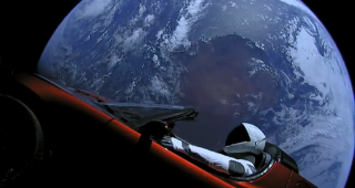 SpaceX's Starman mannequin is seen inside Elon Musk's red Tesla Roadster in space, with the brilliant Earth in frame, in this jaw-dropping view from a camera on the car. SpaceX launched the mannequin and Roadster into space on the first Falcon Heavy test flight on Feb. 6, 2018, then beamed back live views from the car.