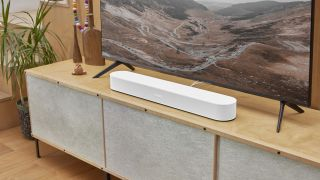 the sonos beam soundbar in white on a TV stand