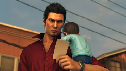 Kiryu looks at a picture, with Haruto cradled on his shoulder.