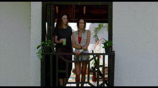 Samantha (Alex Essoe) brings Christine (Maggie Q) a smoothie after a traumatic night in Darren Lynn Bousman's 'Death Of Me'.