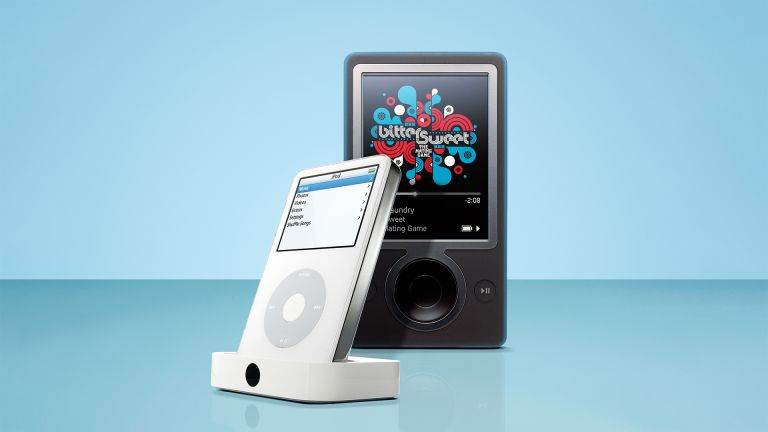 Apple iPhone in white and Zune in black on blue background
