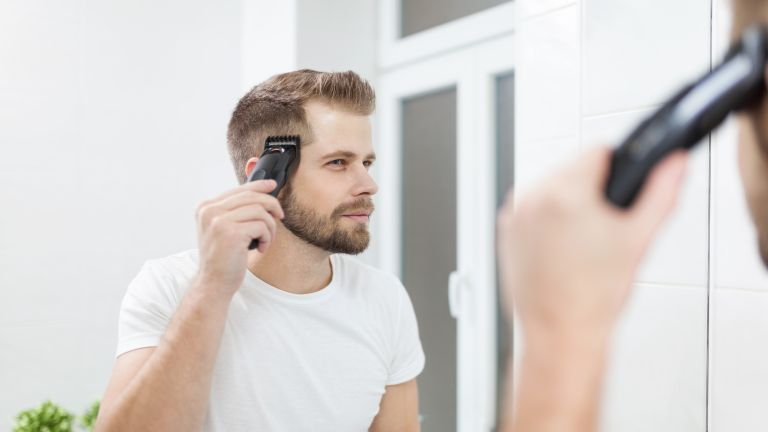 A man looking in the mirror and shaving the side of his head – these are the best hair clippers
