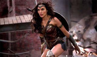 Gal Gadot Wonder Woman standing near rubble