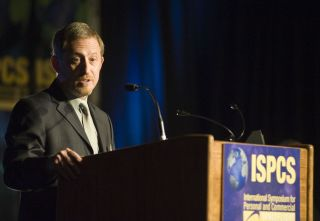 Planetary scientist Alan Stern, principal investigator of NASA's New Horizons mission to Pluto, speaks at the 2009 International Symposium for Personal and Commercial Spaceflight. (Stern is involved in a number of spaceflight and space science endeavors.)