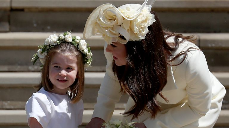 Princess Charlotte of Cambridge stands on the steps with her mother Catherine, Duchess of Cambridge after the wedding of Prince Harry and Ms. Meghan Markle at St George's Chapel at Windsor Castle on May 19, 2018 in Windsor, England