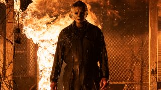 Michael Myers stands in front of a housefire in Halloween Kills.