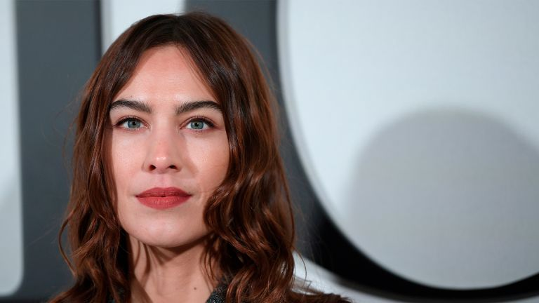 British model and socialite Alexa Chung poses during the photocall prior to the Dior Women's Fall-Winter 2020-2021 Ready-to-Wear collection fashion show in Paris, on February 25, 2020. (Photo by Anne-Christine POUJOULAT / AFP) (Photo by ANNE-CHRISTINE POUJOULAT/AFP via Getty Images)
