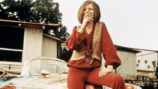 Janis Joplin with her painted Porsche, which fetched $1.76 million at auction