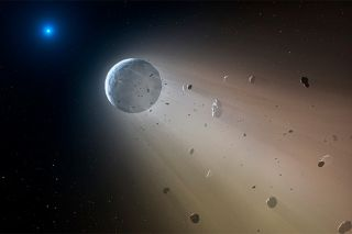 Artist's impression of WD 1145+017 (white dwarf star, at left) and a planet shedding