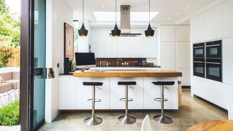 How to add value to a house: kitchen extension with contemporary feel, breakfast bar and wooden stools by keith collie