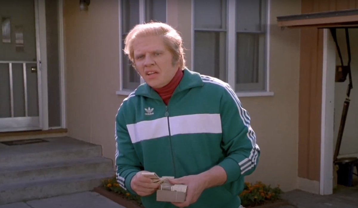 Back To The Future Part II Biff standing in his tracksuit, ready to pass out matchbooks