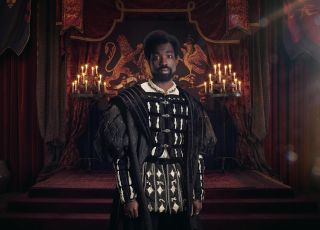 Paapa Essiedu standing in the throne room as George Boleyn
