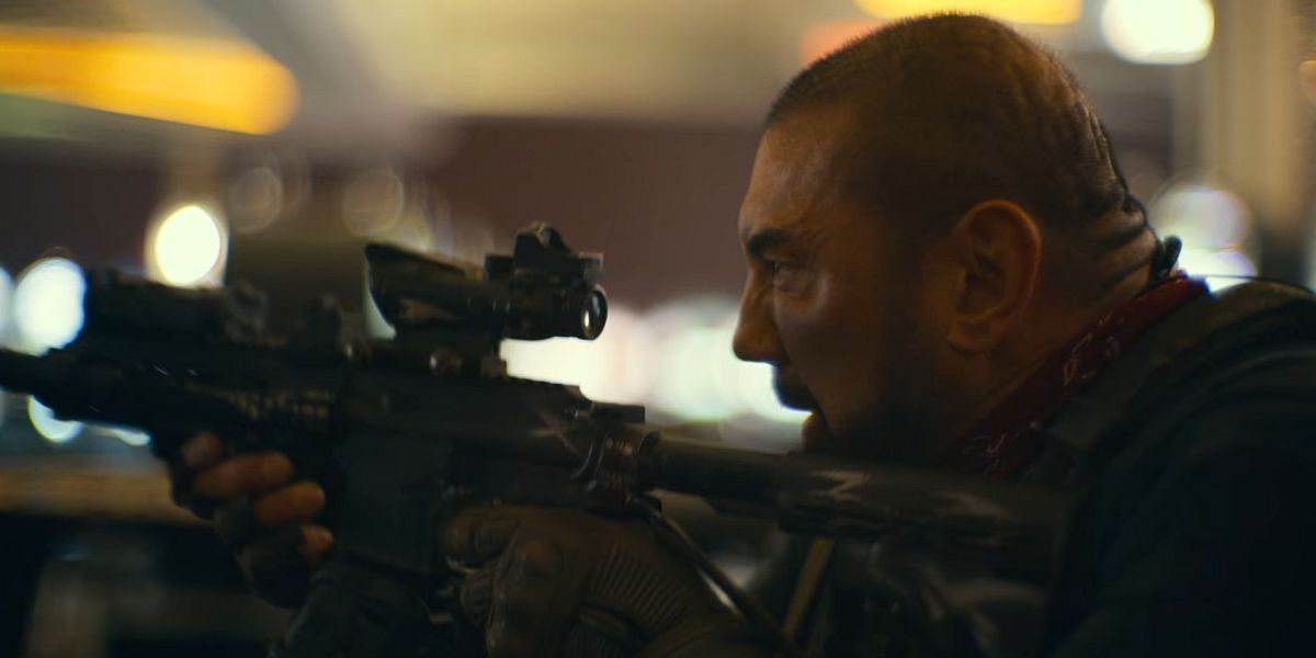 Dave Bautista firing a gun in Army of the Dead