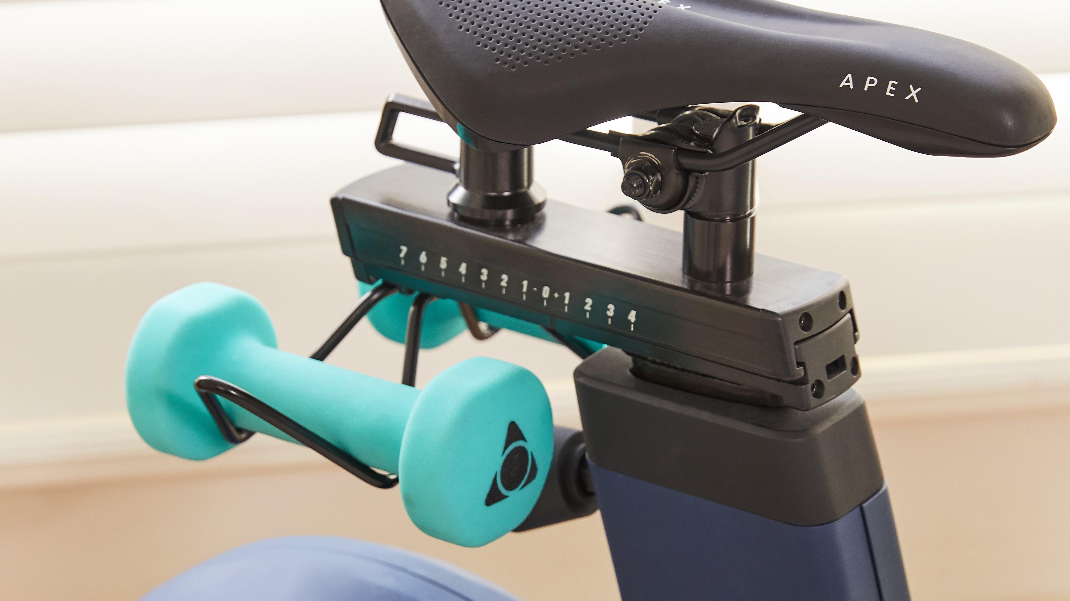 Storage for hand weights under Apex Bike saddle