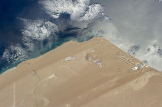 This astronaut photograph of the Saharan coastline was captured on May 20, 2014, by Expedition 40 aboard the International Space Station.