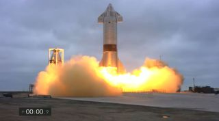 SpaceX's Starship SN15 rocket prototype launches on a 10-kilometer test flight from SpaceX's Starbase test site near Boca Chica Village in South Texas on May 5, 2021.