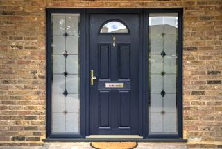a composite front door with glass panels on either side