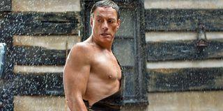 Jean-Claude Van Damme stands in the rain in a scene from Jean-Claude Van Johnson